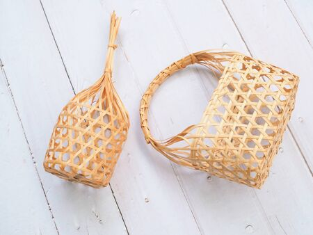 Top view of round bamboo basket and weaving basket handbag traditional culture fashion thai style on wooden table.