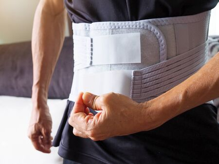 Elderly men with back pain support belt or medical belt, orthopedic lumbar support. Banque d'images