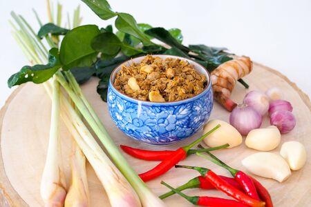 Thai cuisine (nam prik) or chili paste. thai southern style food with chilli, garlic, onion And lemongrass in Thai blue bowl.