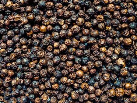 Background wallpaper herbs and spices with black pepper.