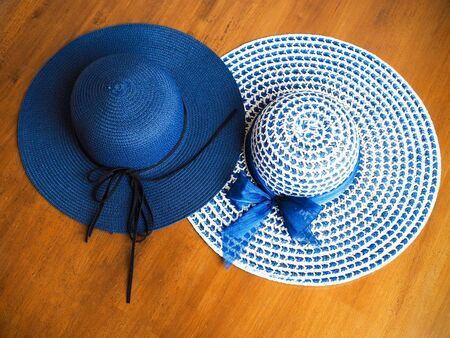 Top view of blue wide brimmed straw hat, summer fashion of women.