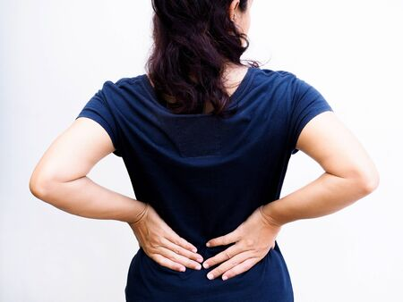 Young thai asian woman suffering low back pain and waist lumbar pain