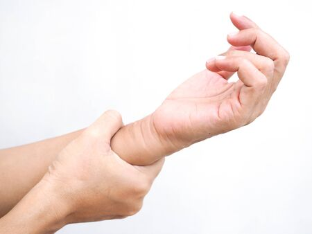 Close-up of hand massage on body with wrist pain and arm aches. Stock Photo