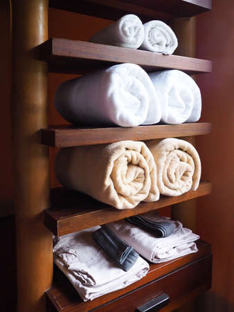 Towel on the shelf, wooden furniture, decorated in the bathroom