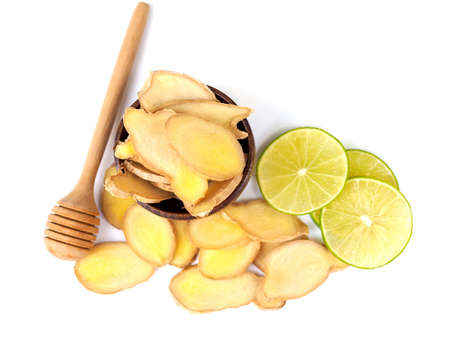 herbs and spices with ginger root and lime lemon citrus slice and honey stick isolated on white background.