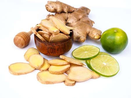herbs ginger root and lime lemon citrus and honey isolated on white background. Stock Photo