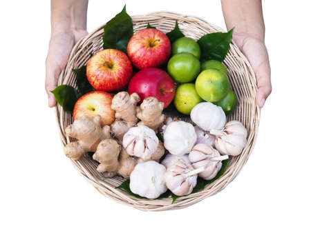 Top view of Fruits and vegetables set in bamboo basket with honey Healthy food on hand isolated on white background with clipping path Stock Photo