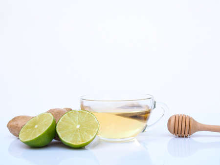 Healthy herbal drink in mug or tea with lemon ginger and honey isolated on white background. Stock Photo
