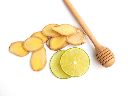 Top view of tea ingredients with lime lemon citrus slice and herbs with ginger and honey isolated on white background. Stock Photo