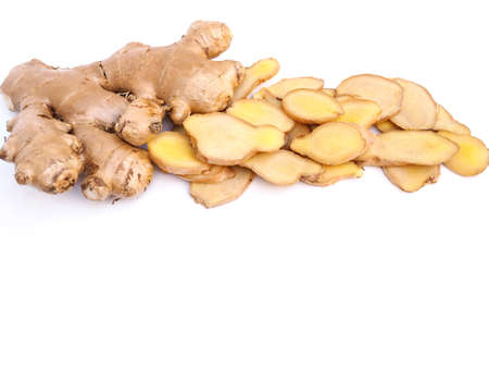 Fresh sliced ginger and ginger root isolated on white background with copy space Stock Photo