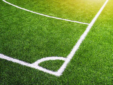 Corner white line on green grass of futsal field or football field