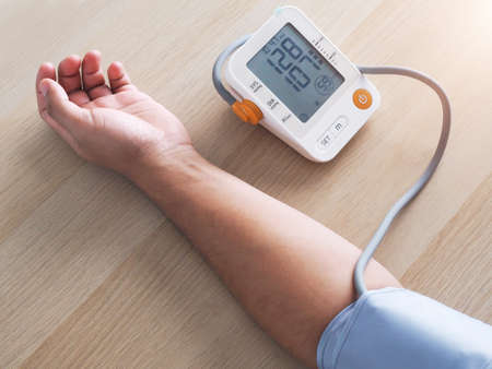 Checking health with digital blood pressure monitors Stock Photo