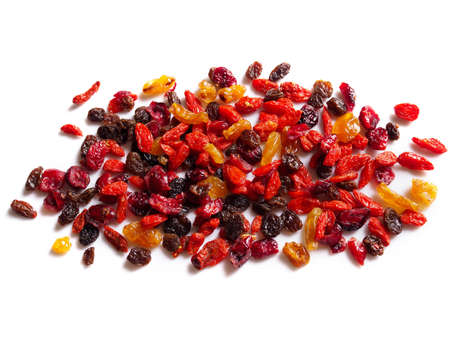 Top view of pile dried fruit with red goji berries dry grape raisins isolated on white background.