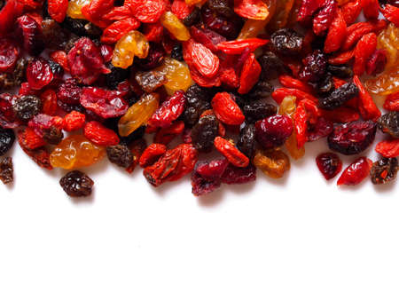 Top frame of dried cereal natural food with goji berry and dry raisin grape fruit isolated on white background.