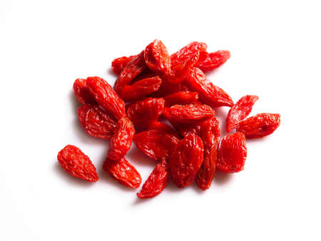 Top view pile of red goji berries isolated on white background.