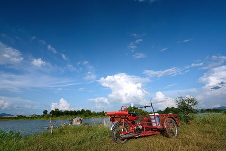 three wheeler: Tricycle with blue sky.