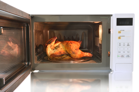 nuke: The microwave oven is warm roasted chicken with black pepper  on white background.