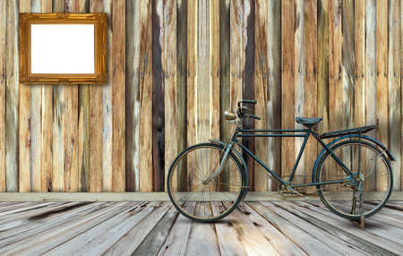 fame: Antique bicycle on wooden wall floor and picture fame
