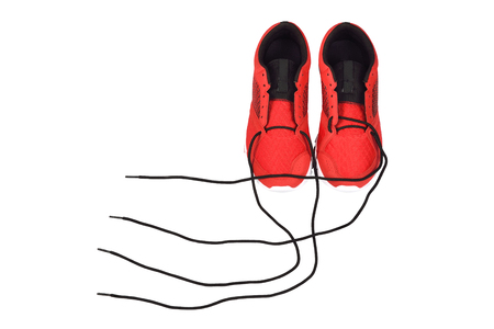 untied: untied shoelace of sneakers on white background. Stock Photo