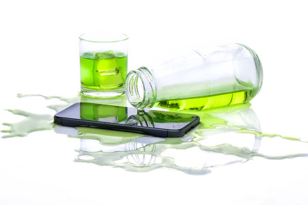 Water in bottle spilled smart phone on white background Stock Photo