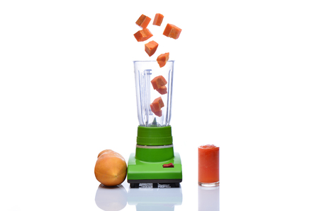 Blender is spinning papaya on white background