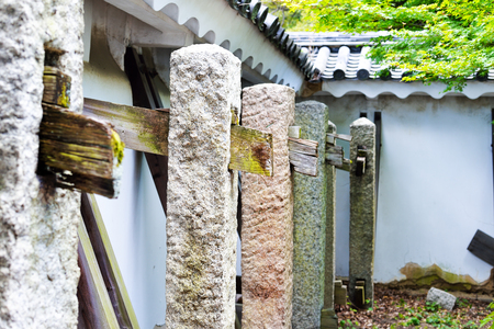 Buttresses of wood and stone holding up the outer walls of Nijo Castle, Kyoto, Japan Banco de Imagens