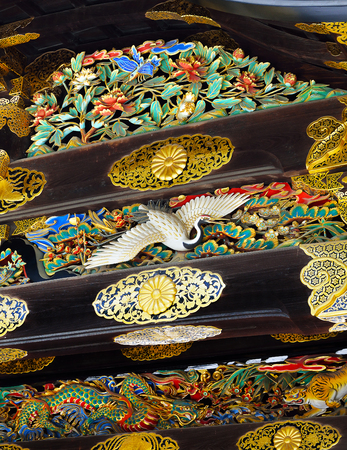 Closeup of the colorful and ornate decorations in Kara-mon Gate, focusing on a carving of a crane, Nijo Castle, Kyoto, Japan Editorial