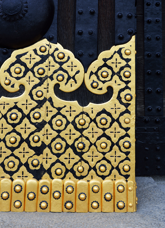 Closeup of the East Gate (Higashi Ote-mon) of Nijo Castle, Kyoto, Japan, showing the gold decorations on its door.