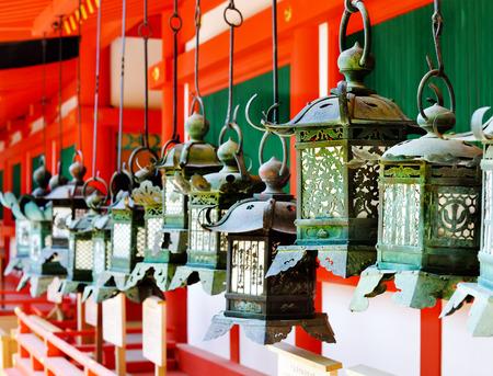 Rows of metal lanterns hanging in Kasuga Taisha Shrine, Nara, Japan Editorial