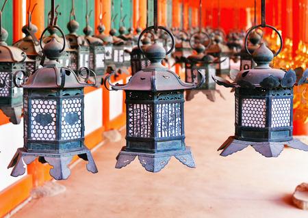 Rows of metal lanterns hanging in Kasuga Taisha Shrine, Nara, Japan Banco de Imagens