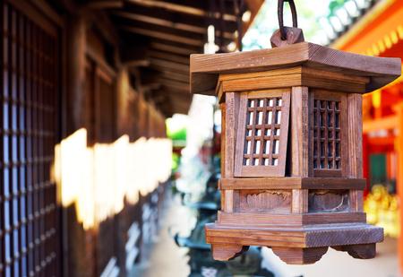 A wooden lantern hanging in Kasuga Taisha Shrine, Nara, Japan