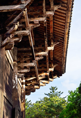 A closeup of the eaves and architecture of Nandaimon Gate, Nara, Japan