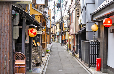 KYOTO, JAPAN - July 24, 2017: Pontocho Street, Kyoto, Japan, lying empty during a hot, muggy day. As one of the old entertainment areas for geishas, the street becomes busy at night.