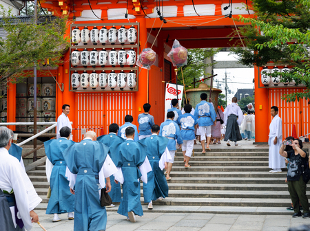 KYOTO, JAPAN - July 24, 2017: Men wearing traditional clothing set our from Yasaka Jinja on a parade as a part of the Gion Matsuri festivities in Kyoto, Japan. Editorial