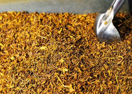 A closeup of a bin of dried tea leaves on sale at a Japanese market