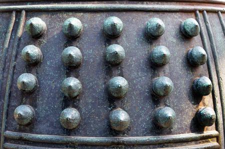 A closeup of an old Japanese bronze bell.