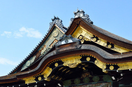 A closeup of the roof of Ninomaru Palace, Nijo Castle, Kyoto, Japan, showing its gold decorative features.