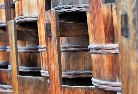 A closeup of some traditional wooden Japanese buckets.