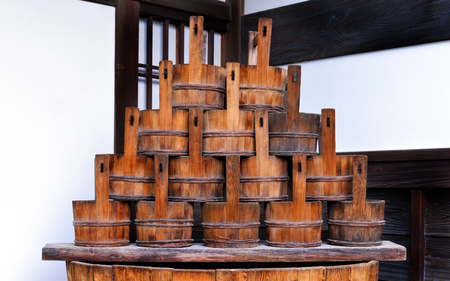 Traditional Japanese wooden buckets sitting atop an old Japanese cask. Banco de Imagens