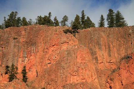 iron oxide: sandstone cliff has a constant sunset color due to iron oxide Stock Photo