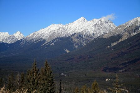 View of Canadian Rocky Mountains with snow on peaks photo