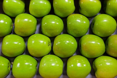 Granny smith apples on a tray in a box photo