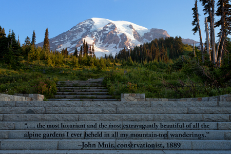 Mt Rainier and John Muir quote on stone steps that lead to several trails Stock Photo