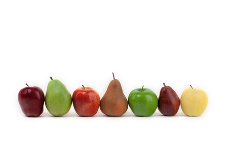 An assortment of apples and pears isolated on a white background all lined up