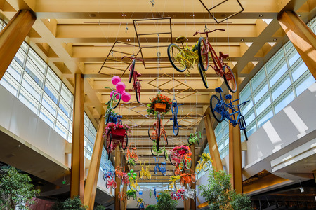 Many colorful bicycles hanging from the ceiling of the Aria Resort & Casino in Las Vegas, Nevada, USA