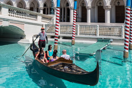 Las Vegas, Nevada, USA - September 1, 2017: Tourists enjoying ride in gondola at Grand Canal at The Venetian Resort Hotel and Casino.  This luxury hotel opened on May 3, 1999 on the Las Vegas strip.