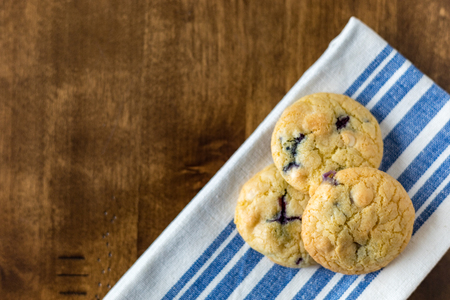 Soft Blueberry and White Chocolate Chip Cookies with fresh blueberries Stock Photo