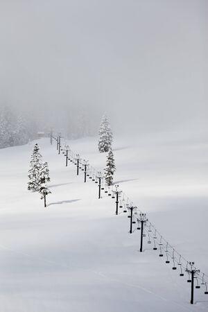 Ski lift and fresh snow in the Cascade Mountains of Washington State Stock Photo