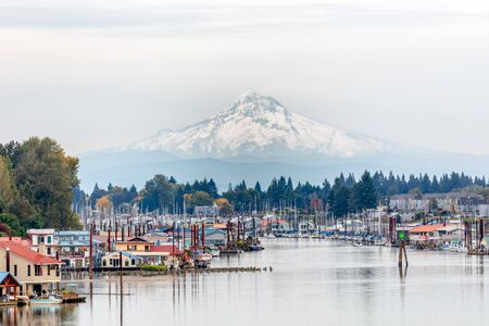View of Mt. Hood and Portland Marina floating boat houses in Oregon, USA