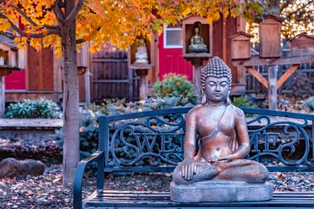 Beautiful Buddhist garden with statue of Buddha with Bhumisparsa mudra Calling the Earth to Witness the Truth